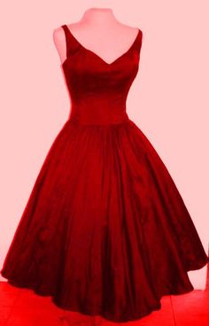 Beautiful 50s inspired red dress with detachable straps. Can be made to measure. $245.00, via Etsy.