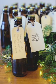 Unique home-brewed beer wedding favors made by the groom | Sevenish Photography | See more: http://theweddingplaybook.com/forest-inspired-foodie-wedding/