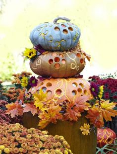 Pumpkin stack with drilled holes! How to make it: http://www.midwestliving.com/homes/seasonal-decorating/pumpkin-decorating-projects/