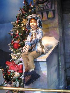 Macy's Christmas Window Tree-Themed Displays: Child in Tree of Friendship Window