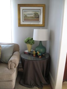 LIVING ROOM - nice use of tablecloth under end table.