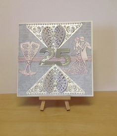 Silver wedding card using the Tattered Lace dies