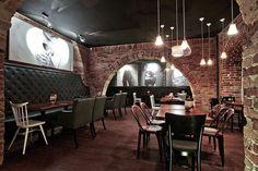 Sofa bar & restaurant by 2kul, Jelenia Góra - Poland I like the black and white photos against the brick