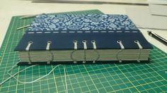 |)(|)(| Handmade journals, curved coptic stitch, handmade bookmark, size: A5, by Siraa Crafts دفتر دست ساز، دوخت دست دوز به شیوه قبطی به صورت قوس دار، جلد پارچه ای دو تکه، چوب الف بافته شده، کاغذ کرافت ۱۰۵ گرمی؛ کالای دست ساز سیرا؛ این دفتر به سفارش ساخته شده است