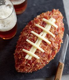 Pigskin Cheese Ball covered in bacon -- good for snacking before Thankgiving | 23 Most Glorious Balls Of Cheese You've Ever Seen