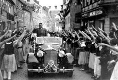 Konrad Henlein is welcomed by enthusiastic crowds in Sudetenland. 1938.