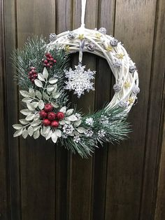 Complete your home decorations with this elegant wreath. It is a beautiful and cheery, Christmas wreath that will make you smile each time you see it! This wreath is made with a combination of Grapevine wreath, frosty white greenery and mini festive bells. Various sizes available, the