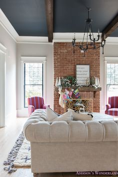 Our new mantle and living room tour! vintage-living-room-black-ceiling-brick-fireplace-dark-wood-beams-anthropologie-home-tufted-sofa-christmas-holiday-decorating-ideas