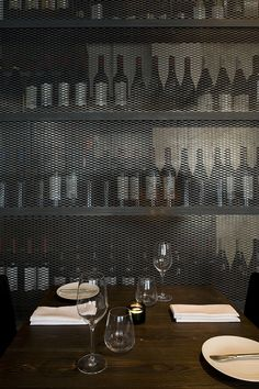 industrial restaurant and bar Dabbous in London (Metal grating as storage or separation wall)