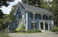 Paint Color Ideas for Colonial Revival Houses 2019 best exterior colors for colonial revival houses dusty blue house with darker blue shutters and white trim The post Paint Color Ideas for Colonial Revival Houses 2019 appeared first on House ideas. Colonial House Exteriors, Colonial Exterior, House Paint Exterior, Exterior Paint Colors, Exterior House Colors, Paint Colors For Home, Exterior Design, Exterior Windows, Stucco Exterior