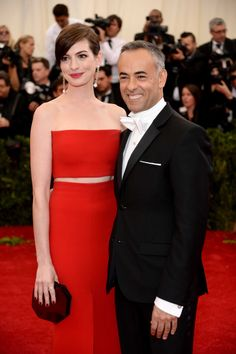 Anne Hathaway in Calvin Klein Collection  at The 2014 Costume Institute Benefit at the Metropolitan Museum of Art with the brands' Women's Creative Director Francisco Costa