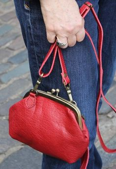 Small clipframe red leather bag with clutch strap