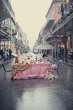 beautiful pink tea party in the middle of this street.....dont mind if i do.