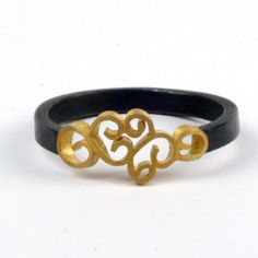 Gold filigree decorates the top of the ring, with a square band in blackened silver. 18K gold filigree and silver.  www.natashajewelry.com