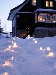 Candles in the snow.  Simple and beautiful.