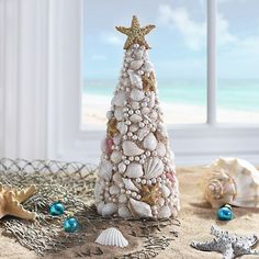 Celebrate Christmas on the coast with our Seashell Christmas Tree Statue! This unique tree is carved with seashells and adorned with a starfish tree topper. Aussie Christmas, Summer Christmas, Christmas Crafts, Christmas Wood, Christmas Stuff, Christmas Trees, Seashell Projects, Seashell Crafts, Driftwood Crafts