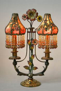 Exceptional pair of French flowered, antique tole candelabra lamp bases with original paint. The Sheik shades are dyed gold to rose and covered in gold metallic lace and antique French chenille flower appliqués. Hand beaded fringe adorns the bottom. Lamp, Chandelier Lamp, Beautiful Lamp, Lace Lamp, Beautiful Lighting, Victorian Lighting, Vintage Lighting, Vintage Lamps, Victorian Lamps