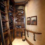 Wine Cellar - mediterranean - wine cellar - charlotte - by Advanced Renovations, Inc.