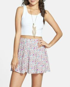 Cute buttons on a cute floral skater skirt.