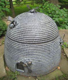 52 FLEA: Home and Garden Tour.... 7 Samuelson Residence  stone bee skep  for the garden hose