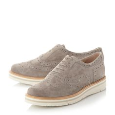 The classic brogue style is given a quirky update with a flatform heel. Features traditional punch hole and wingtip detail and a lace up fastening. The contrast mid sole and sole provides a standout finish.
