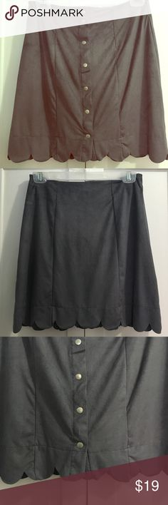 Brand New Gray Mini Skirt - Faux Suede Material Brand New Gray Mini Skirt - Faux Suede Material. Never worn and flawless.  Size L.  Button detail and decorate hem.  Pair it with a t shirt or bundle it with my cutie gray tank for a slimming look.  Interi Skirts Mini