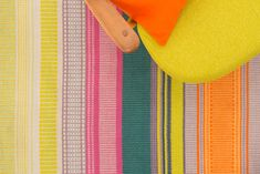 Bring a joyful burst of colour to your home with this ethically produced rug made from recycled plastic bottles.  Woven by hand in India from recycled PET yarn, the rug is completely washable and can be used outdoors and indoors, perfect for terraces, balconies and garden rooms too.  Perfect for bringing a burst of colour to your living space this popular size is ideal for sitting rooms and bedrooms. Dimensions: 180cm x 120cm  Designed by Angie Parker and inspired by Bristols vibrant street…
