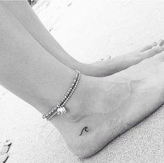Wave, palm tree, sun, anchor