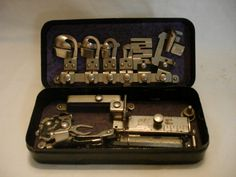 VINTAGE GREIST SEWING MACHINE ATTACHMENTS IN ROTARY BOX