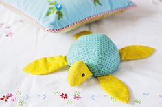 this cute little turtle is one of the up-coming projects in The Art of Quilting, will you be making him? #quilt #quilting #quiltingmagazine #patchwork #sewing #fabric #crafts #softtoy #plushie #turtle #theartofquilting #artofquilting
