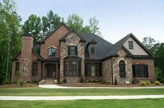 Stone and Brick Exterior with dark trim and gutters