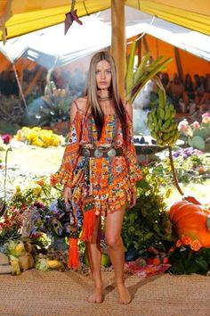 Cute little boho frock with ruffle hem detail & cinched in at the waist with an ethnic leather belt. Camilla Franks.