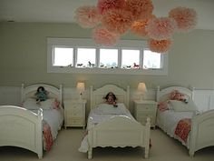aww...I just love the idea of 3 little girls sleeping in this room...probably lots of sweet giggles would be heard :)