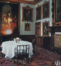 Van Dyck's monumental equestrian portrait of King Charles I dominates the dining room; other 17th-century portraits are predominantly English. The table is scaled for intimacy; appointed with Hepplewhite chairs, it rests on a Caucasian rug.