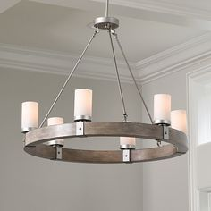 The rustic wood frame and riveted black metal strapping defining our Arturo Chandelier creat Dinning Room Light Fixture, Round Light Fixture, Dining Table Chandelier, Round Chandelier, Rustic Chandelier, Dining Room Lighting, Chandelier Lighting, Living Room Chandeliers, Wheel Chandelier