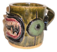 Eye Coffee Cup 8  Stoneware clay slab pot with pattern of molded fangs and eyes by Aaron Nosheny / Aberrant Ceramics.
