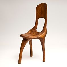 In the manner of Mogens Lassen or Wendell Castle - tripod chair with organic forms.    http://www.galerieriviera.com