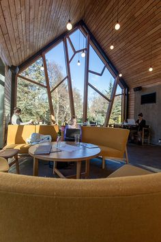 Sensational Coffee Shop Design with Natural Surrounding: Fabulous Coffee Hotspot Interior Upholstered Bench Round Coffee Table