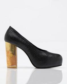 "Gold Heel Pump  Shakuhachi    Textured leather pump with gold wrapped chunky heel from Shakuhachi. Padded foot bed. Leather sole.    4.25"" heel height  1"" front platform"