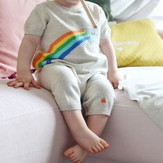 Look at those tiny toes! So cute! Thanks @poupeerousse for sharing this gorgeous pic of our SPARKS shooting star playsuit 😘🌈 30% OFF ALL SS17 ONLINE NOW - Use code: 'FLASH30' (link in bio) limited time and selling out fast! | British designed unisex baby and kids fashion clothing brand for stylish little ones. The bonnie mob ship worldwide from the UK.  #babyclo