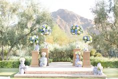 Twilight blue and blush pink wedding. Periwinkle and white hydrangeas, and blush pink and white roses. Wooden candelabras. Blue and white damask vases. Bride in a twilight blue wedding dress and groom in a white dinner jacket.