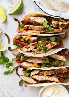 Chicken seared in a wicked homemade Fajita Seasoning so you get that gorgeous crust, then stuffed inside tortillas with chargrilled capsicum/bell peppers and onion. Colourful, flavour loaded and just happens to be healthy! Makes about 15 tacos. http://recipetineats.com