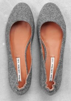 """Basic ballerina flats made from a sturdy, salt and pepper fabric with tan leather lining."" (& other stories website)"