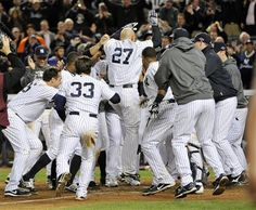 ALDS GAME 3: Wednesday, Oct. 10, 2012 - New York Yankees' Raul Ibanez (27) celebrates with teammates as he reaches home plate after hitting the game-winning home run during the 12th inning of Game 3 of the American League division baseball series against the Baltimore Orioles in New York. The Yankees won 3-2.