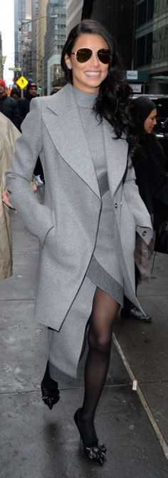 Who made Adriana Lima's gray coat and wrap circle dress?