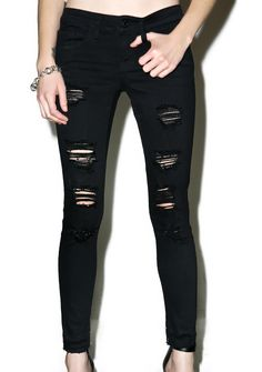 Sabotage Distressed Skinny Jeans are gunna ruin 'em with a single look, bb. These insane skinnies feature a stretchy 'n curve huggin' black denim construction, mid rise, shredded panels down the thighs and knees, and classic zipper fly 'n button closure.