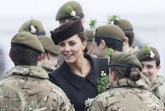 Enjoying the day: The Duchess was all smiles as she met the men and women of the Irish Guards in Aldershot