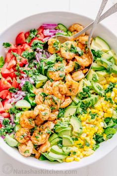 We could live off this shrimp avocado salad. It\'s crazy good and loaded with avocado, cucumbers, tomatoes, sweet corn and tossed with a light and easy cilantro-lemon dressing. This shrimp salad has all the best flavors of summer! WINNER!! | natashaskitchen.com