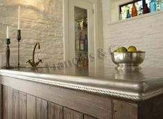 Countertop-Pewter: A masterful mix Constantine shelf successfully displays a beautiful French oak braced by two pewter quoins. Metal Countertops, Kitchen Countertops, Atlanta, Italian Home, French Oak, Stone Flooring, New Living Room, Fresh, Beautiful Interiors