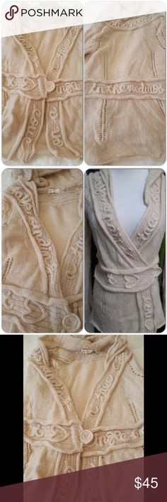"""Rare Anthropologie cardigan Beautiful unique light but warm cardigan, with beautiful squiggly words all around the cardigan. Bust laying flat 17"""", waist 14"""", length 25"""". Double breasted buttons at waist. No wholes, great condition. Anthropologie Sweaters Cardigans"""